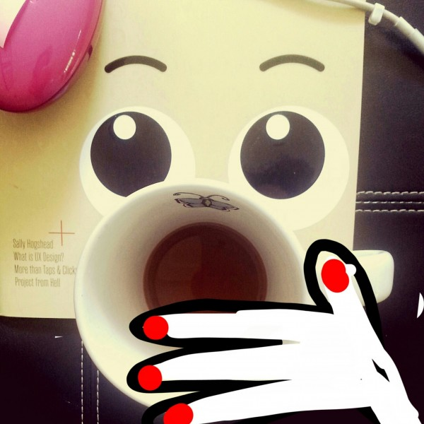 face with coffee cup