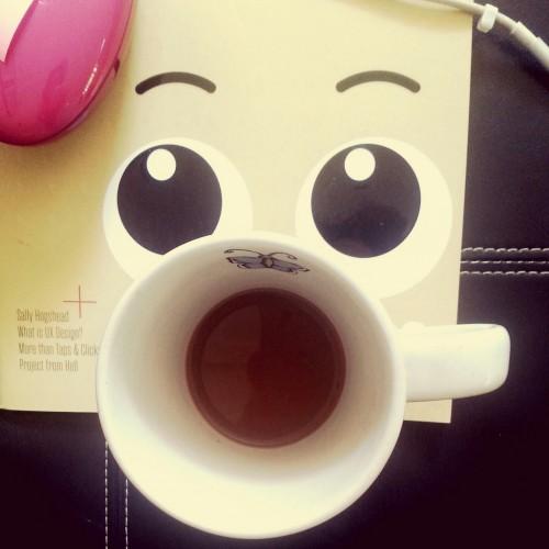 shocked face with coffee cup