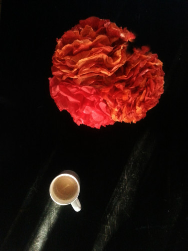 paper flowers, coffee, dust and sunlight.