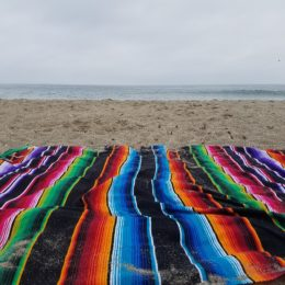 mexican blanket on the beach